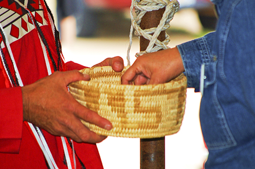 Don Holding Weaved Basket full of Tobacco